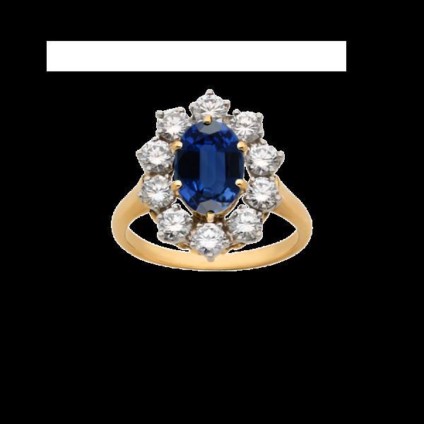 Bague Marguerite en or jaune 18 carats et platine sertie d'un saphir ovale entouré de diamants de taille brillant.