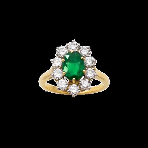 Bague Marguerite en or jaune 18 carats et platine sertie d'une émeraude ovale entourée de diamants taille brillant.