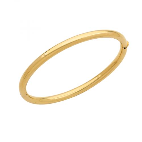 Bracelet jonc ouvrant en or jaune 18 carats. Le bracelet est un ovale de 58 millimètres de diamètre qui convient à la plupart des poignets. Sa section est section ronde, de 5 millimètres de diamètre.