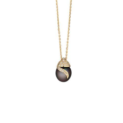 Pendentif Aladin en or jaune 18 carats serti de diamants et d'une perle de Tahiti.