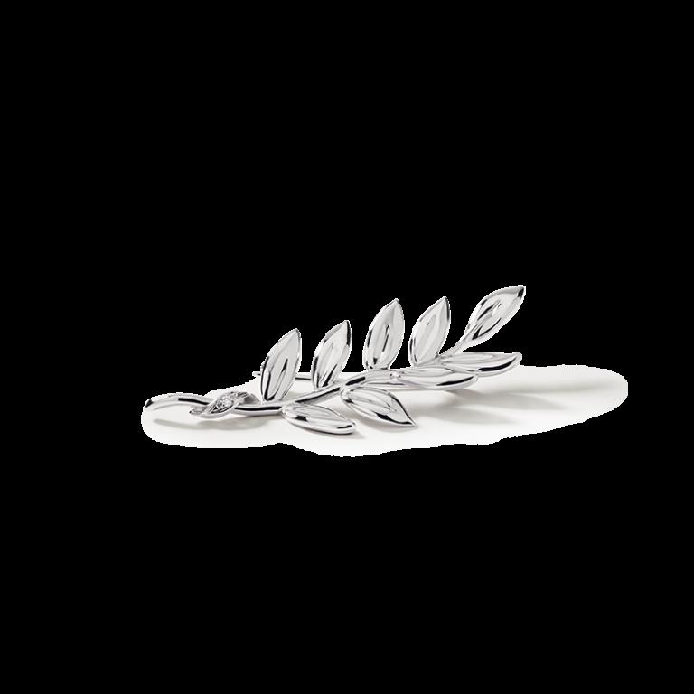 Broche en forme de branche de rameau, en or blanc 18 carats. La branche est sertie d'un diamant.