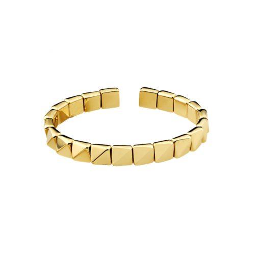 Bracelet en or jaune 18 carats, ouvert et flexible, composé de motifs facettés.