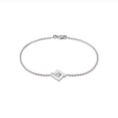 Bracelet de la collection Signature en or blanc 18 carats, composé du motif iconique, le losange, serti en son centre d'un diamant taille brillant
